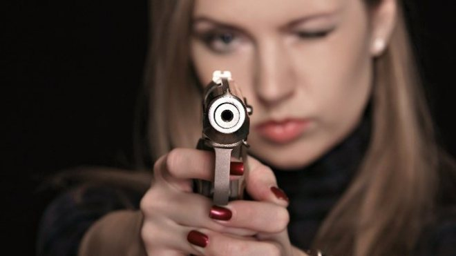 6948182-cool-girl-with-gun